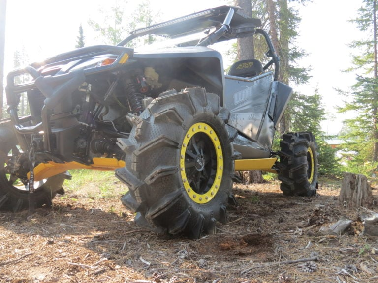 Why are utv tires smaller in the front than the rear?